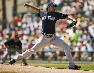 New York Yankees starter Sergio Mitre pitches against the Baltimore Orioles during the first inning of a MLB spring training game in Sarasota, Florida, March 22, 2011. REUTERS/Steve Nesius