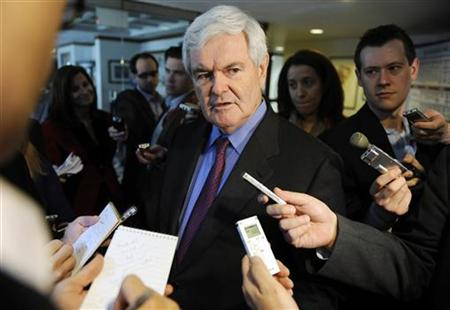 Former U.S. House Speaker Newt Gingrich (R-GA) (C) speaks to reporters after a news conference at the National Press Club in Washington, March 18, 2011. REUTERS/Jonathan Ernst