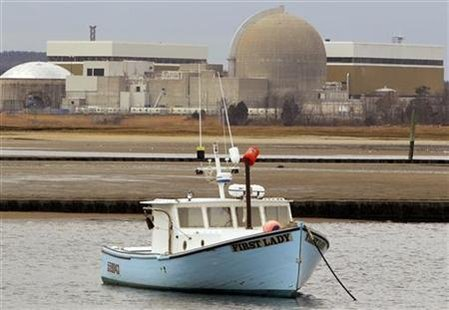 A fishing boat is anchored in the water in front of the nuclear power station in Seabrook, New Hampshire March 14, 2011. REUTERS/Brian Snyder