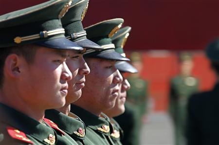 Paramilitary policemen attend a daily training session at the Forbidden City in central Beijing March 3, 2011. REUTERS/Petar Kujundzic