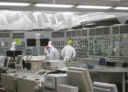 People work in the control room of reactor No. 2 with restored lighting at the earthquake and tsunami affected Fukushima Daiichi nuclear power plant in Fukushima in this March 26, 2011 photo from Tokyo Electric Power Co. made available by Kyodo. REUTERS/Tokyo Electric Power Co./Kyodo
