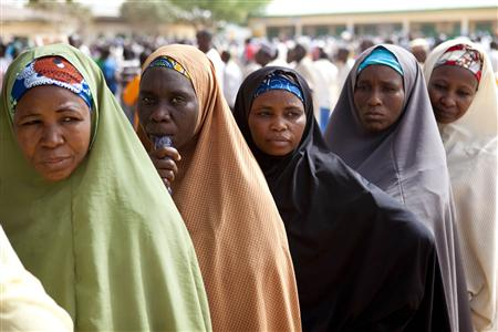 Voters queue to register during parliamentary elections in Kano, northern Nigeria, April 1, 2011. REUTERS/Joseph Penney
