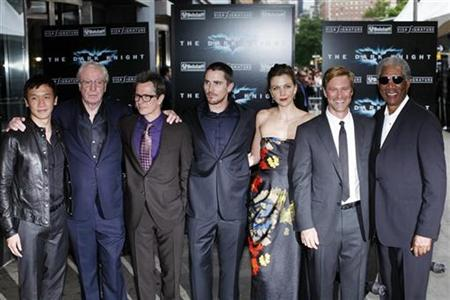 Actors (L-R) Chin Han, Michael Caine, Gary Oldman, Christian Bale, Maggie Gyllenhaal, Aaron Eckhart and Morgan Freeman pose for photographers during the premiere of the film The Dark Knight in New York, July 14, 2008. REUTERS/Keith Bedford