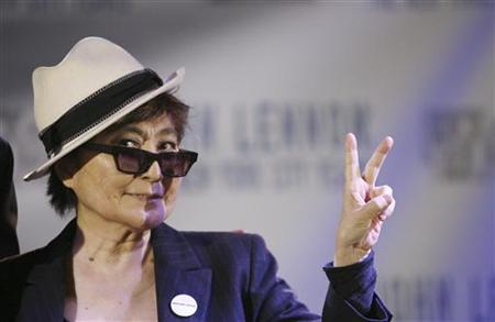 "Yoko Ono gestures as she unveils the ""John Lennon: The New York City Years"" exhibit at the Rock & Roll Hall of Fame Annex in New York May 11, 2009. REUTERS/Lucas Jackson"