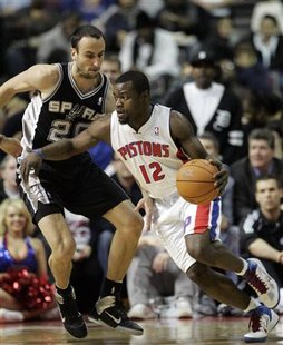 Detroit Pistons guard Will Bynum (R) drives against San Antonio Spurs guard Manu Ginobili during the second half of their NBA basketball game in Auburn Hills, Michigan February 8, 2011. REUTERS/Rebecca Cook