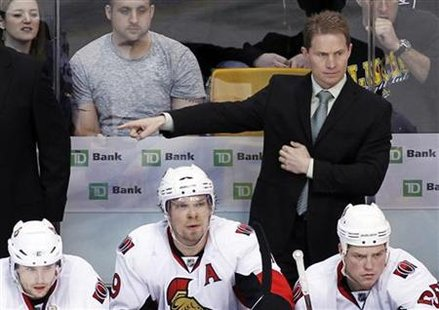 Ottawa Senators head coach Cory Clouston gives direction from the bench during the third period of their NHL hockey game against the Boston Bruins in Boston, Massachusetts April 9, 2011. REUTERS/Greg M Cooper
