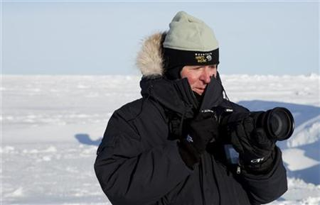 Secretary of the Navy, Ray Mabus, photographs ice structures in the Arctic near the 2011 Applied Physics Laboratory Ice Station north of Prudhoe Bay, Alaska March 18, 2011. REUTERS/Lucas Jackson