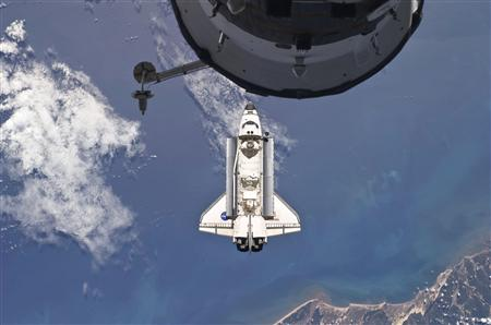 The Space Shuttle Atlantis is backdropped against the Earth prior to docking with the International Space Station, with a portion of a docked Russian spacecraft in the foreground in this photo released by NASA and taken May 16, 2010. Picture taken May 16, 2010. REUTERS/NASA Handout