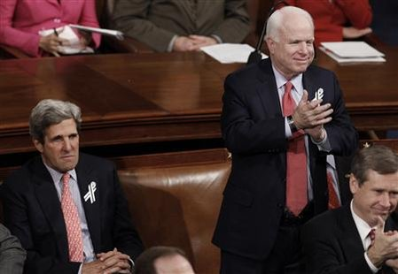 U. S. Senator John McCain (R-AZ) applauds as fellow Senator John Kerry (D-MA) looks on during U.S. President Barack Obama's State of the Union address to a joint session of Congress on Capitol Hill in Washington, January 25, 2011. REUTERS/Jim Young