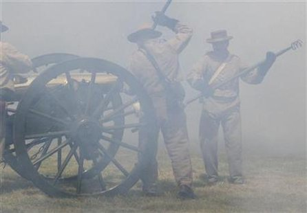 Gunners in Civil War garb load a bronze cannon in smoke from a previous blast, during an artillery demonstration at Antietam National Battlefield in Sharpsburg, Maryland, June 9, 2007. REUTERS/David Alexander