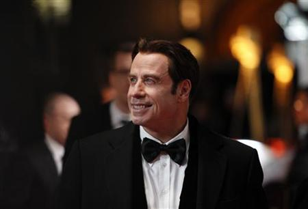 U.S. actor John Travolta arrives on the red carpet for the 46th 'Goldene Kamera' (Golden Camera) awards ceremony at the Ullstein Auditorium in Berlin, February 5, 2011. REUTERS/Thomas Peter