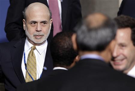 U.S. Federal Reserve Chairman Ben Bernanke attends the IMF governors family photo of the spring IMF-World Bank meetings in Washington April 16, 2011. REUTERS/Yuri Gripas