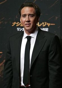"U.S. actor Nicolas Cage poses for photographers during a promotional event for the film ""National Treasure: Book of Secrets"" in Tokyo December 5, 2007. REUTERS/Michael Caronna"