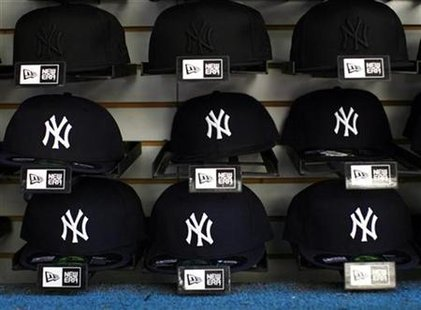 Hats are displayed at a shop outside Yankee Stadium in the Bronx borough of New York September 20, 2008. REUTERS/Eric Thayer