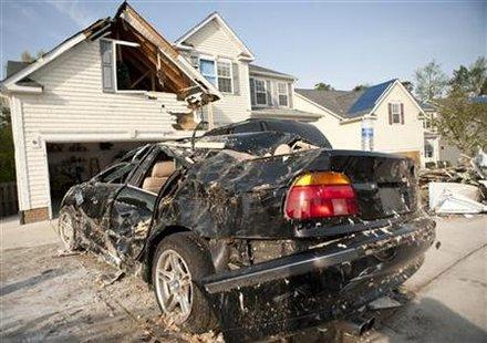 18, 2011 after a tornado hit the neighborhood. REUTERS/Jon Gardiner