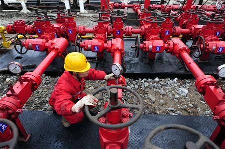 A worker performs a routine check to the valves at a natural gas appraisal well of Sinopec in Langzhong county, Sichuan province, in this file picture taken March 1, 2011. Just over a year ago, Beijing awakened to a technology revolution that has unlocked massive reserves of gas trapped within shale rock formations in the United States. China's confidence has been bolstered by a new report of its estimated reserves of shale gas, which shows them