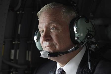 Defense Secretary Robert Gates flies on a Blackhawk helicopter back to Camp Victory after meeting with Iraq's president and prime minister in Baghdad April 7, 2011. REUTERS/Chip Somodevilla/Pool