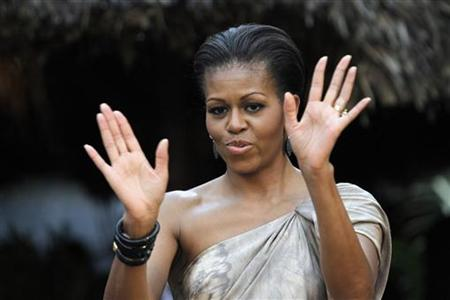 First lady Michelle Obama gestures during a visit with young Brazilians who have participated in a range of U.S.-sponsored development programs, in Brasilia March 19, 2011. REUTERS/Ueslei Marcelino