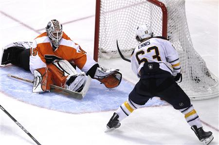 Buffalo Sabres winger Tyler Ennis (63) scores the game winning goal against Philadelphia Flyers goalie Michael Leighton (49) during the overtime period of Game 5 of their NHL Eastern Conference quarter-final hockey game in Philadelphia, Pennsylvania April 22, 2011. REUTERS/Tim Shaffer