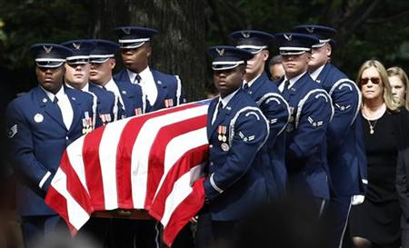 Catherine Stevens, widow of former Senator Ted Stevens (R-AK), walks behind the flag-draped casket during his burial ceremony at Arlington National Cemetery in Arlington, Virginia, September 28, 2010. REUTERS/Jim Young