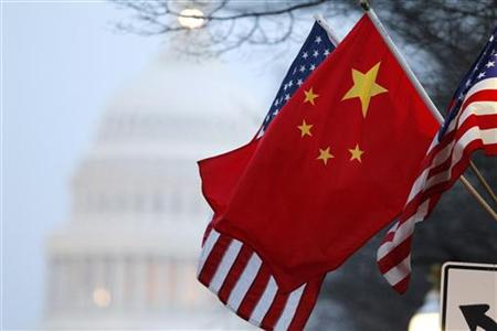 The People's Republic of China flag and the U.S. Stars and Stripes fly along Pennsylvania Avenue near the U.S. Capitol in Washington in this January 18, 2011 file photo.REUTERS/Hyungwon Kang