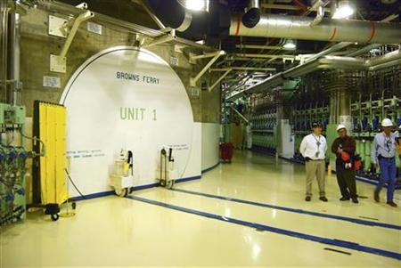Nuclear officials stand near the entrance to a reactor at the Browns Ferry nuclear facility in Alabama, in this photo taken March 25, 2011. REUTERS/Matthew Bigg
