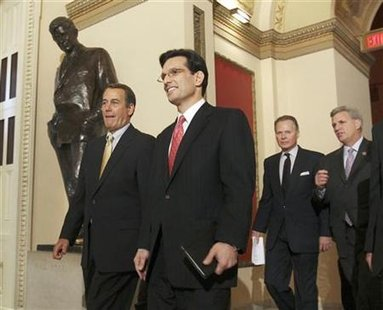 House Republican Leader John Boehner (L) and Republican Whip Eric Cantor (2nd L) lead the Republican members of Congress into the House of Representatives chamber to begin the vote on health care reform on Capitol Hill in Washington, March 21, 2010. REUTERS/Larry Downing