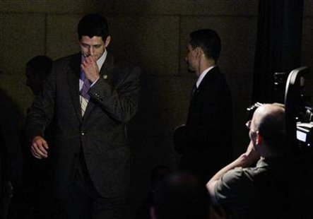 Paul Ryan (R-WI), Chairman of the House Budget Committee, walks backstage at the Peter G. REUTERS/Jason Reed