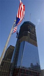 The new One World Trade Center building is under construction next to the site of the September 11 World Trade Center attacks in New York, May 10, 2011. REUTERS/Ray Stubblebine