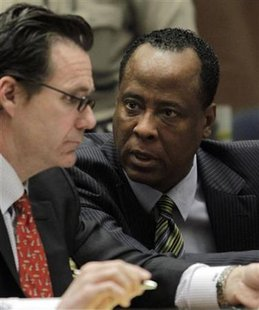Doctor Conrad Murray (R), the late Michael Jackson's personal physician, confers with his lawyer Edward Chernoff during his arraignment on a charge of involuntary manslaughter in the pop star's death, in Los Angeles, California, January 25, 2011. REUTERS/Pool/Irfan Khan
