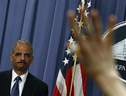 Attorney General Eric Holder listens to a question at a news conference to announce Medicare Fraud Strike Force law enforcement actions in Washington, February 17, 2011. REUTERS/Jim Young