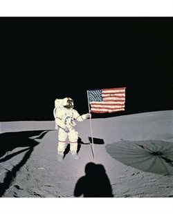 Alan Shepard, the first American in space, is shown planting a U.S. flag on the lunar surface during the Apollo 14 mission in this file photo. REUTERS/NASA