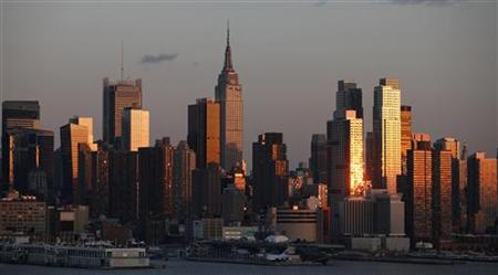 The sun sets on the skyline of Manhattan in New York, March 19, 2011. REUTERS/Gary Hershorn