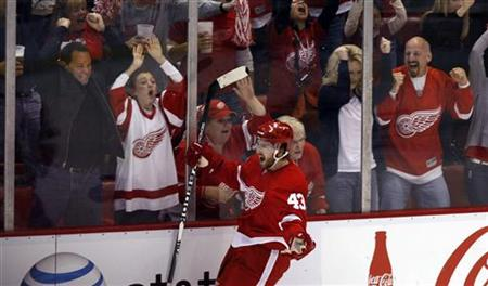 Detroit Red Wings' Darren Helm and fans celebrate his goal against the San Jose Sharks during the third period of Game 4 in their NHL Western Conference semifinal hockey playoff in Detroit, Michigan May 6, 2011. REUTERS/Rebecca Cook