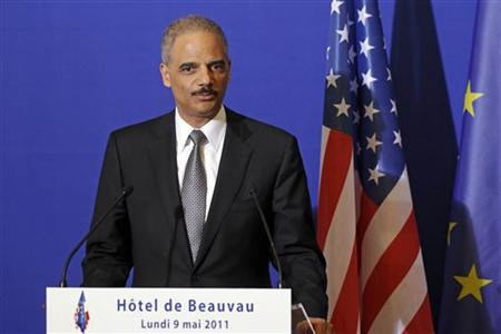 Attorney General Eric Holder attends a press conference at the Interior Ministry in Paris on May 9, 2011. REUTERS/Benoit Tessier