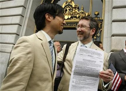 Same sex couple Thom Watson (R) and Jeff Tabaco show their marriage license application prior to a judge lifting the Proposition 8 stay on same sex marriages at City Hall in San Francisco, California August 12, 2010. REUTERS/Robert Galbraith
