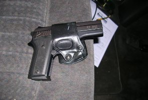 The gun found in the suspect's vehicle.