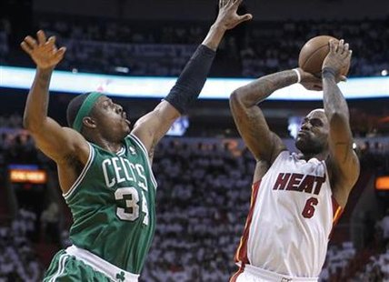 Miami Heat's LeBron James (R) shoots over Boston Celtics' Paul Pierce during Game 5 of their NBA Eastern Conference basketball playoff series in Miami, May 11, 2011. REUTERS/Joe Skipper