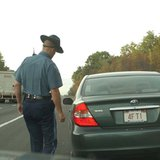 A police officer making a traffic stop.