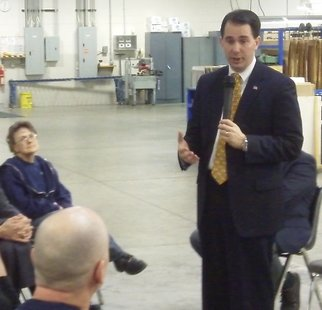 Governor Scott Walker speaks with workers at Wausau Container Corporation.