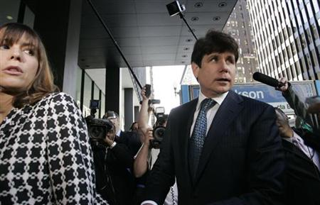 Former Illinois Governor Rod Blagojevich (R) and his wife Patti enter the Dirksen Federal building for the start of his corruption trial in Chicago, Illinois in this June 3, 2010 file photo. REUTERS/Frank Polich