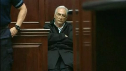 Dominique Strauss-Kahn sits in a courtroom