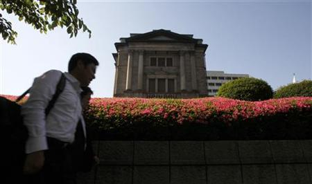 A man passes the Bank of Japan headquarters in Tokyo May 19, 2011. REUTERS/Yuriko Nakao