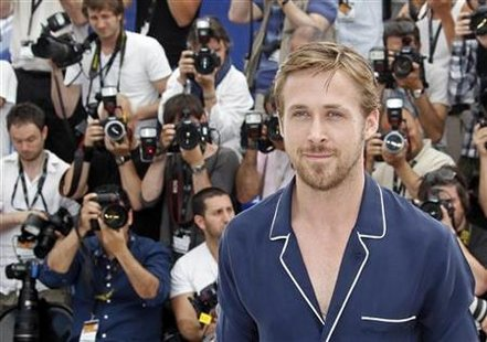 "Actor Ryan Gosling poses during a photocall for the film ""Drive"" in competition at the 64th Cannes Film Festival, May 20, 2011. REUTERS/Jean-Paul Pelissier"