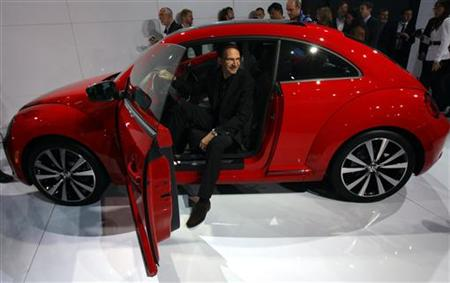Klaus Bischoff, Volkswagen head of design, sits inside the 2012 Volkswagen Beetle at the U.S. Reveal, an event showcasing the redesigned model, in New York April 18, 2011. REUTERS/Mike Segar