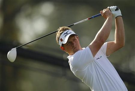 luke donald masters 2011. Luke Donald of England hits