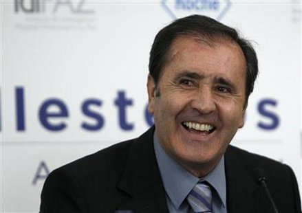 Spain's former golf player Severiano Ballesteros laughs during a news conference in Madrid
