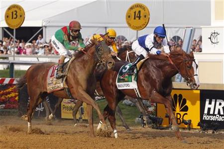 Shackleford with Castanon in the irons finishes ahead of Animal Kingdom and jockey Velazquez during the 136th running of the Preakness Stake