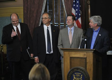 State Budget Director John Nixon gives the governor a thumbs up at a May 27, 2011 press conference to announce the House and Senate have completed the state budget five days earlier than the self-imposed deadline of May 31st.  Also pictured left to right are House Appropriations Chair state Rep. Chuck Moss and House Speaker Jase Bolger.