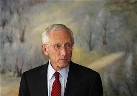 Fischer, the Governor of the Bank of Israel, attends a news conference in Jerusalem
